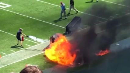 Fire burns on sideline before start of NFL game