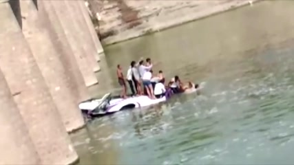 Wedding party bus falls into India river, killing at least 24