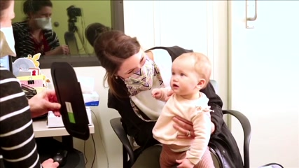 Girl with hearing loss responds to her mother's voice for first time